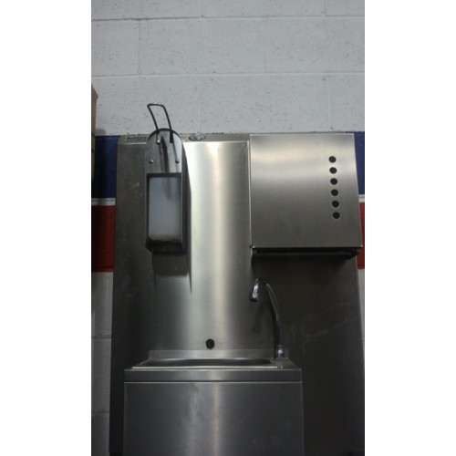 Wall Sink with sensor and soap dispenser.